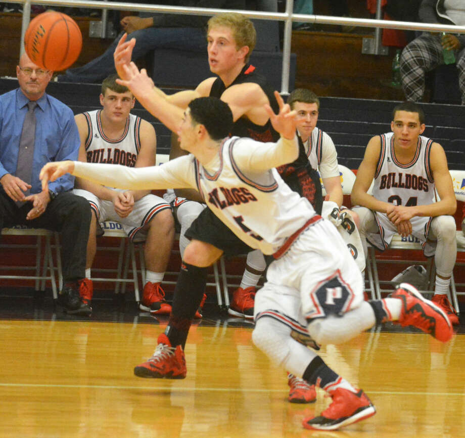 Plainview's Jayton Ellis (foreground) steals the ball from a Lubbock Cooper player early in the first quarter of a District 4-5A boys basketball game at the Dog House Tuesday night. The Bulldogs prevailed in a tussle, 60-57, to improve to 4-1 in district. Photo: Skip Leon/Plainview Herald