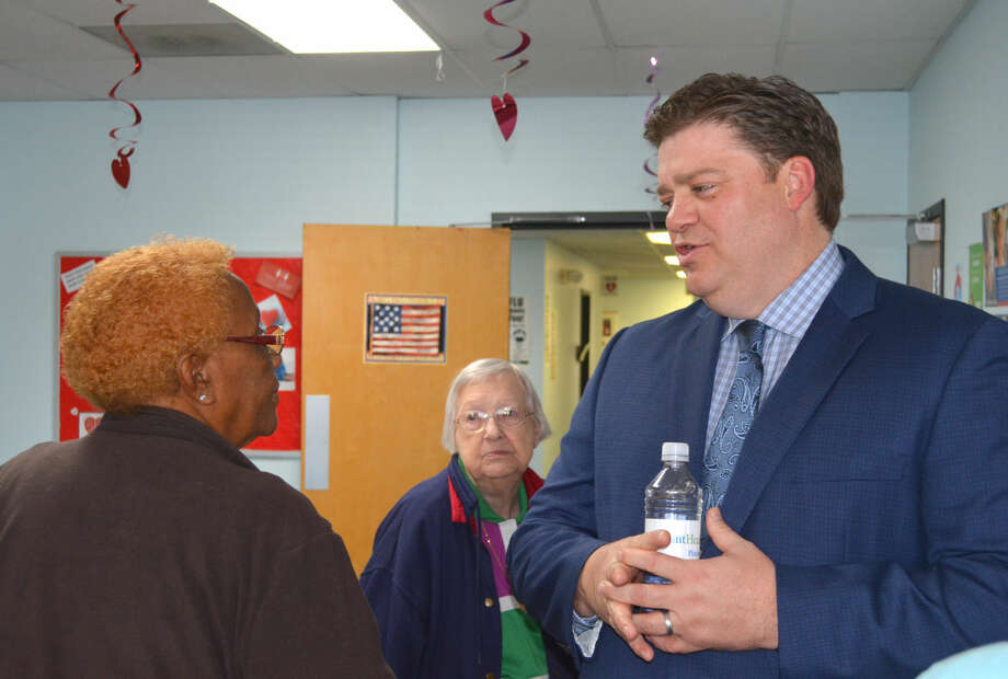 Doug McDonough/Plainview Herald Dr. Kevin Jones, local cardiologist, visits with one of the 30-plus members of the public attending Thursday's quarterly health forum at the Plainview-Hale County Health Department clinic. In keeping with February being Heart Month, the forum was on cardiac care issues. The programs are sponsored by the City-County Health Department and Covenant Health Plainview.