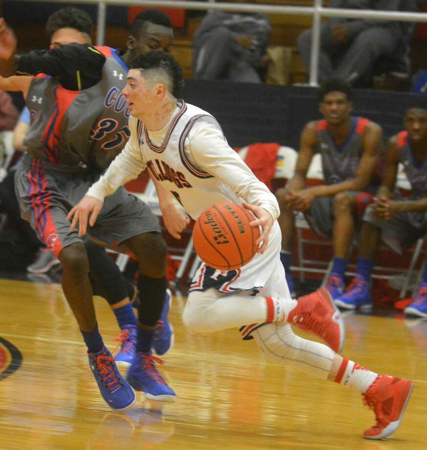 Plainview point guard Jayton Ellis, shown dribbling past a defender during a game this season, was voted the District 4-5A Most Valuable Player for the second consecutive year. Photo: Skip Leon/Plainview Herald