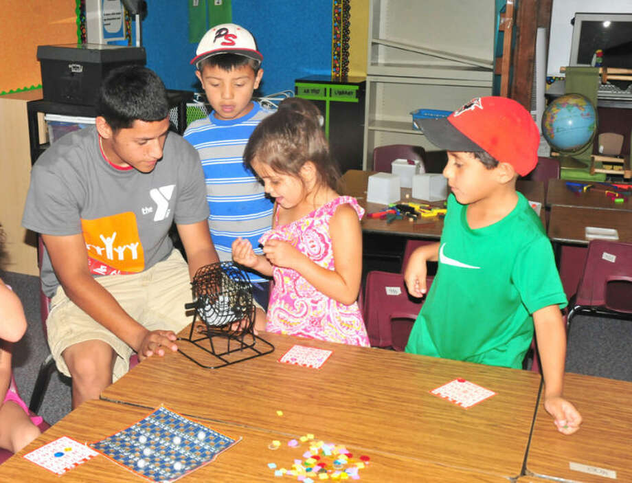 Homer Marquez/Plainview HeraldYMCA SAFE Camp counselor Danny Gallardo directs a round of Bingo for campers Elijah Solis, Jabrey Martinez and Zachary Soliz on Friday.