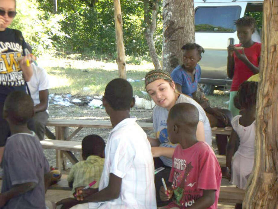 Wayland Baptist University PhotoWayland sophomore Ashley Teague talks to Haitian children during a recent mission trip to Haiti.
