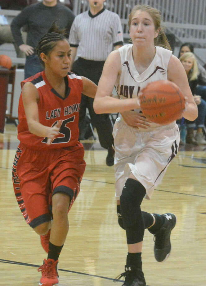 Abernathy's Madelyn Turner, right, looks to pass the ball as she is guarded by Lockney's Reagan Nuncio during a game this season. Turner, a 5-foot-9 junior guard, was voted the District 4-2A Most Valuable Player. Nuncio, a freshman, was voted the district Newcomer of the Year. Photo: Skip Leon/Plainview Herald