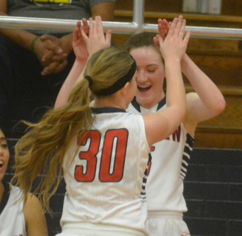 Plainview's Jaden Gonzales (30) and Meredith McDonough are jubilant during the Lady Bulldogs' game against San Angelo Lake View earlier this season. Gonzales scored 20 points Friday night as Plainview won at Lake View and clinched the District 4-5A championship. Photo: Skip Leon/Plainview Herald
