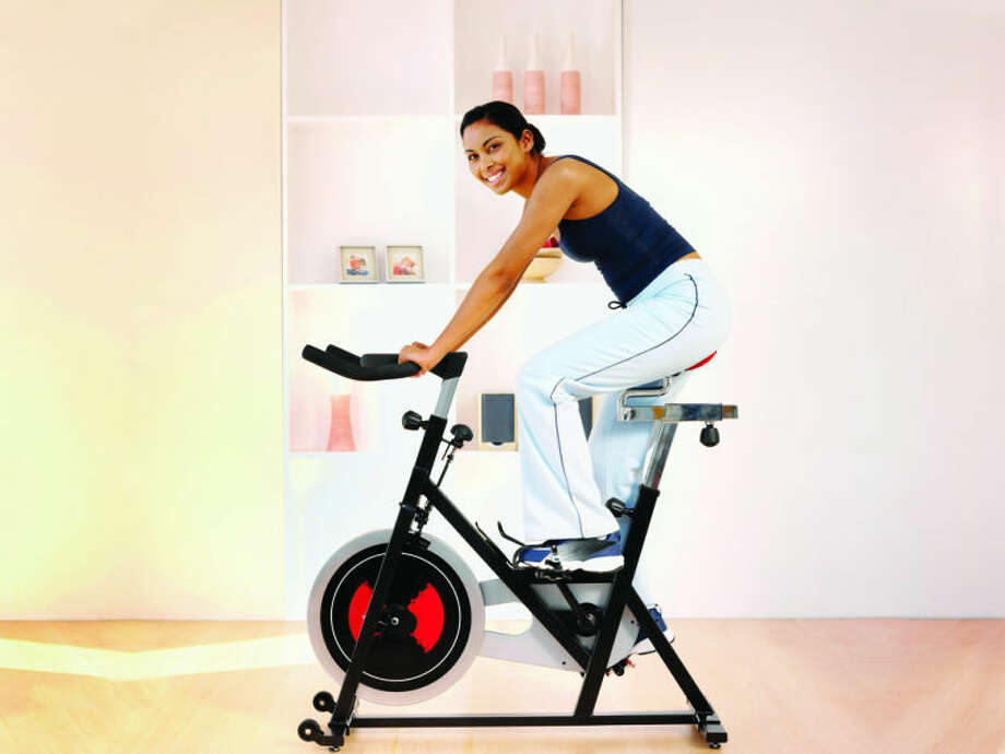 While spin bikes have long been popular in gyms, Consumer Reports notes that these machines are now available for home workouts. Photo: Stockbyte, Getty Images