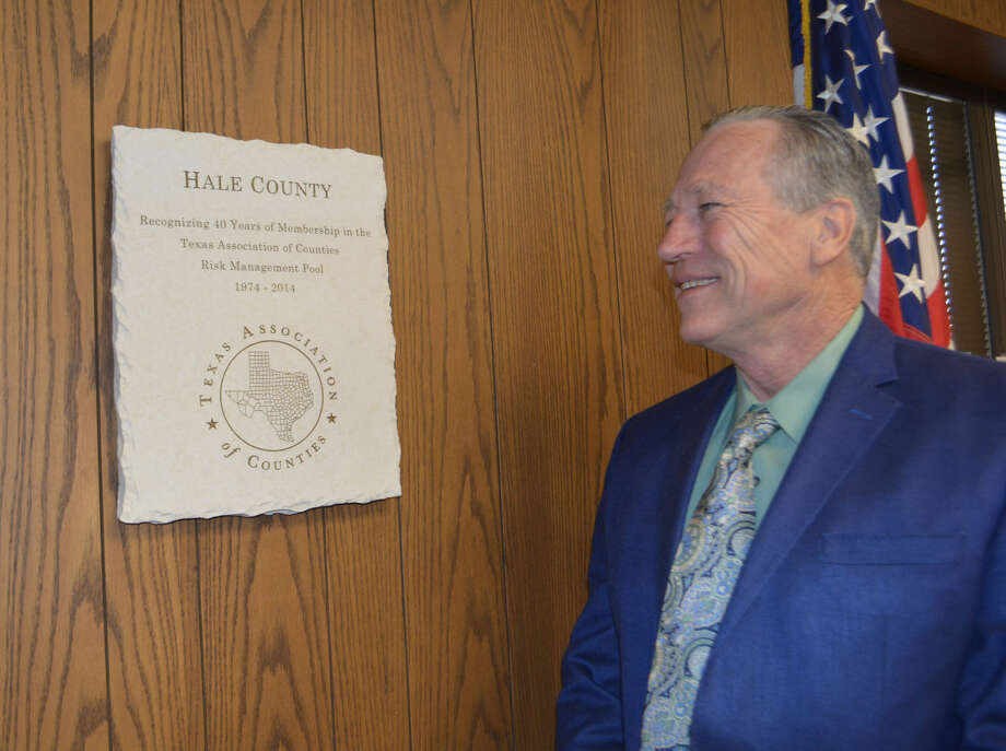 Doug McDonough/Plainview HeraldPrecinct 3 Commissioner Kenny Kernell examines a new plaque in the Hale County Commissioners Courtroom, on the first floor of the courthouse. Etched into a heavy block of limestone, the unique recognition is from the Texas Association of Counties signifying that Hale County for the past 40 years has been a member of its Risk Management Pool. The county received the award at the organization's recent state conference.