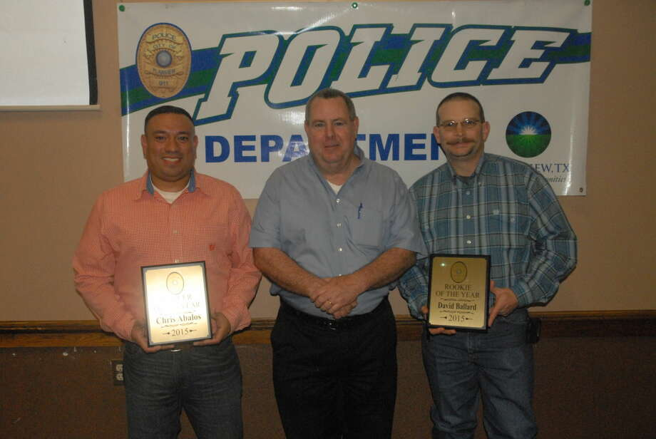 Earning the 2015 Officer of the Year Award at Friday's annual Police Banquet was peace officer Chris Abalos (left), who has served with the Plainview Police Department for the last four years. Police Chief Ken Coughlin (center) presented Plainview's Rookie of the Year award to officer David Ballard. Photo: Homer Marquez/Plainview Herald