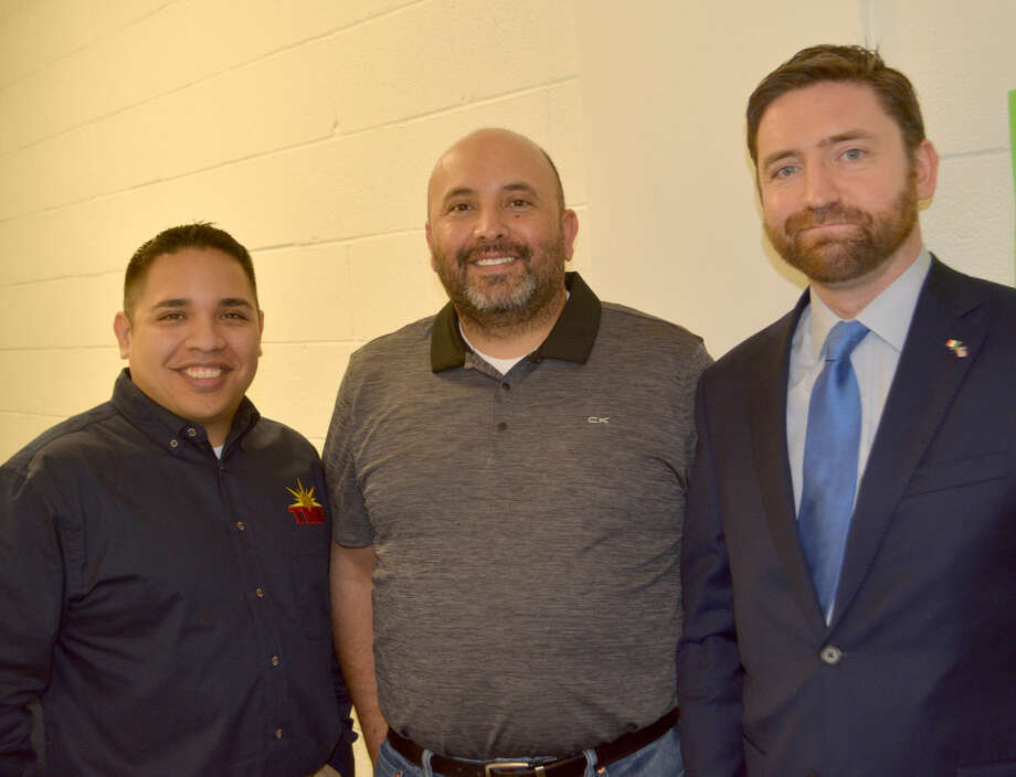 Doug McDonough/Plainview Herald Adrian Farrell (right), consul general of Ireland, pauses outside a PHS classroom on Friday to visit with Eddie Lopez of Austin, representative of TMF Tours, and Anthony Gonzales, PHS band director. Stationed in Austin, Farrell was at PHS to tell band students what to expect during their 2017 St. Patrick's Day visit to Dublin.