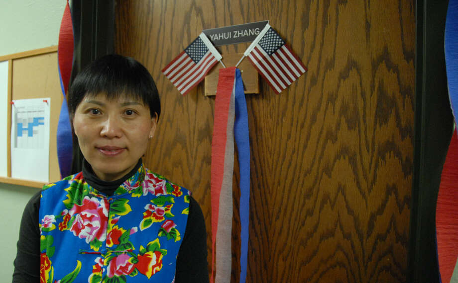 Jonathan Petty/Wayland Baptist University Wayland Baptist University Associate Professor of Communication and Media Studies Dr. Yahui Zhang stands outside her office door that was decorated with American flags and streamers. The hallway outside her office was also decorated with red, white and blue streamers and balloons in celebration of her completing the citizenship process, and being sworn in as a United States citizen.