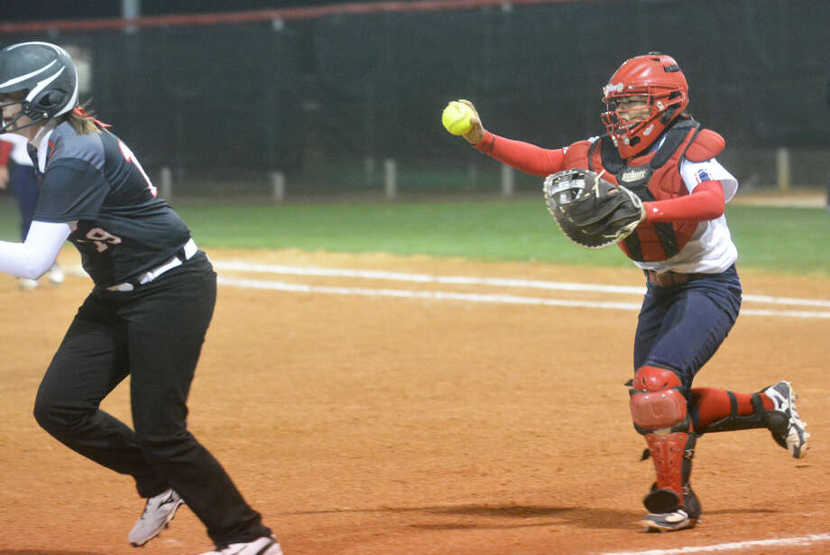 Plainview catcher Erica Chavez, right, chases a Tascosa runner back toward third base during a softball game in Plainview Tuesday night. Chavez caught the runner and tagged her out on the play. The teams played to a 7-7 tie after seven innings when lightning forced the end of the game. Photo: Skip Leon/Plainview Herald