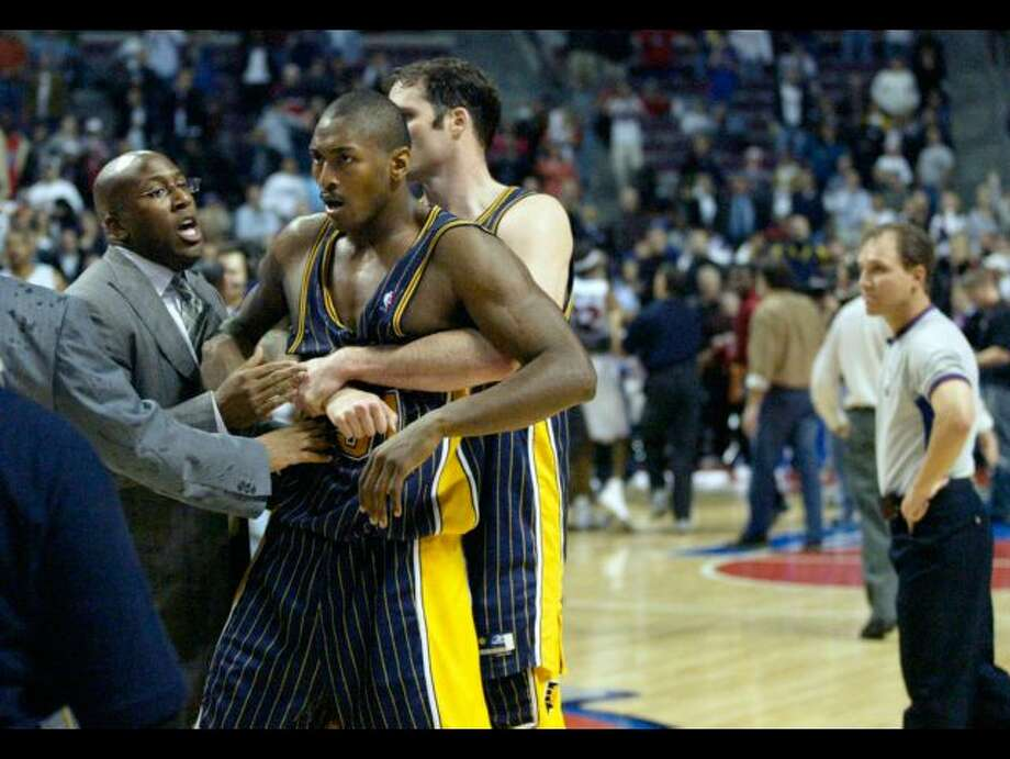 n this Nov. 19, 2004 file photo, Indiana Pacers' Ron Artest is restrained before being escorted off the court following a fight with the Detroit Pistons and fans in Auburn Hills, Mich. Artest, now known as Metta World Peace and with the New York Knicks, believes Marcus Smart can learn from the fallout that will come after the Oklahoma State All-American shoved a fan during an NCAA college basketball game at Texas Tech on Saturday, Feb. 8, 2014. Smart was suspended three games by the Big 12 on Sunday. (AP Photo/Duane In this Nov. 19, 2004 file photo, Indiana Pacers' Ron Artest is restrained before being escorted off the court following a fight with the Detroit Pistons and fans in Auburn Hills, Mich. Artest, now known as Metta World Peace and with the New York Knicks, believes Marcus Smart can learn from the fallout that will come after the Oklahoma State All-American shoved a fan during an NCAA college basketball game at Texas Tech on Saturday, Feb. 8, 2014. Smart was suspended three games by the Big 12 on Sunday.AP Photo/Duane Burleson