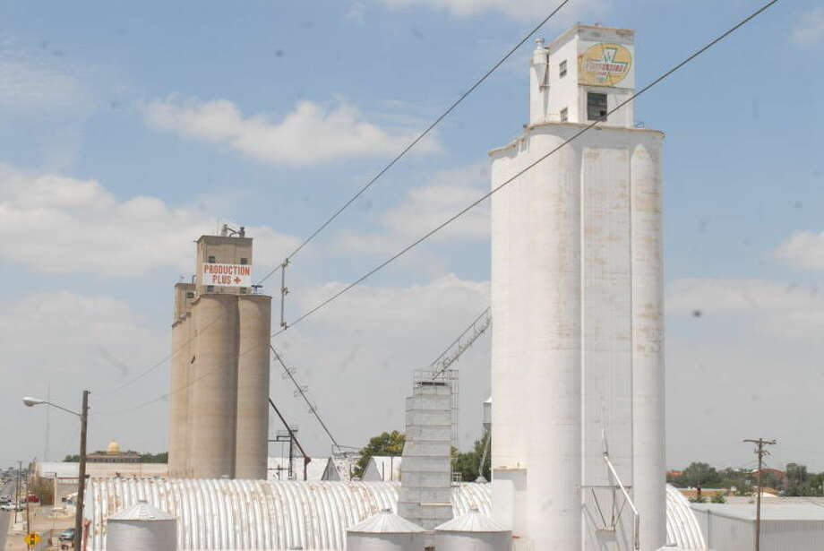 Plainview's seed supplier Production Plus recently was purchased by New Deal seed operators Chromatin. Above, Productions Plus elevators are one of the first sights as eastbound drivers come into town from US 70.