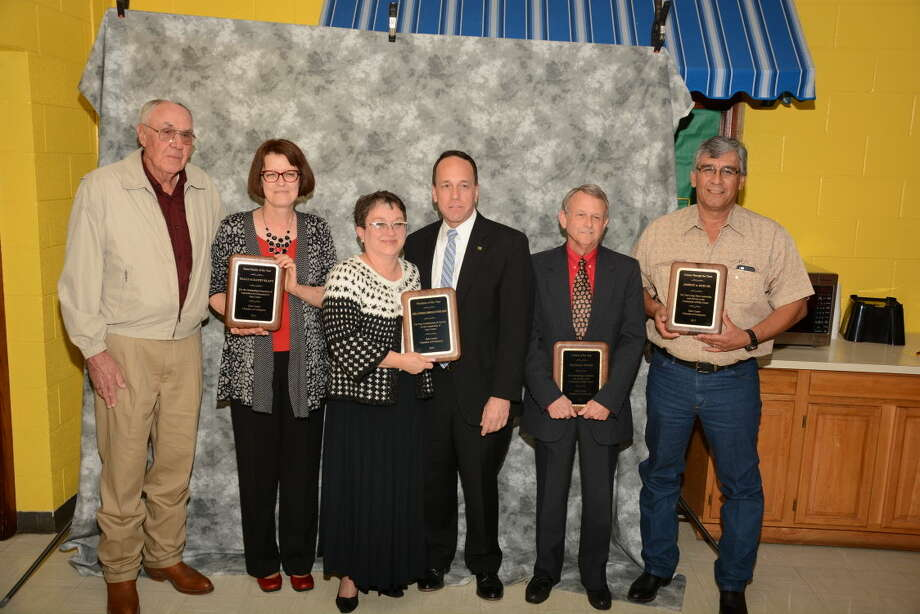 Hale Center Honorees Photo courtesy of Jeff Wertz Recognized at Hale Center's Chamber of Commerce and Agriculture Banquet Saturday were Wally and Kathy Klatt (left) as the Farm Family of the Year; Carley and Todd Abell of Abell Funeral Home and Flower Shop as the 2015 Hale Center Business of the Year; Randall Faith as the 2015 Citizen of the Year and Johnny A Ruiz Jr. as the Citizen Through the Years recipient. Photo: Photo By Jeff Wertz