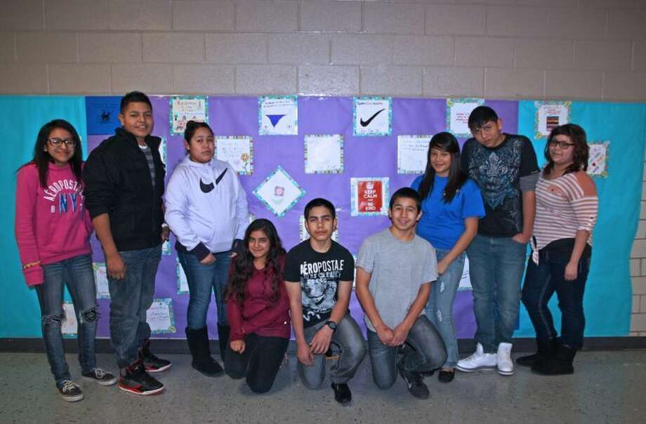 "Estacado students Rosalba Sanchez (left), Miguel Tafolla, Betsy Banales Hernandez, Arantxa Rivera Cedillo, Alexis Gomez, Omar Rivera, Evelyn Barrientos Molina, Oscar Flores and Kayla Torres Hernandez assembled a ""Kindness"" quilt from squares designed by each advisory classroom. Photo: Jan Seago/Plainview ISD"