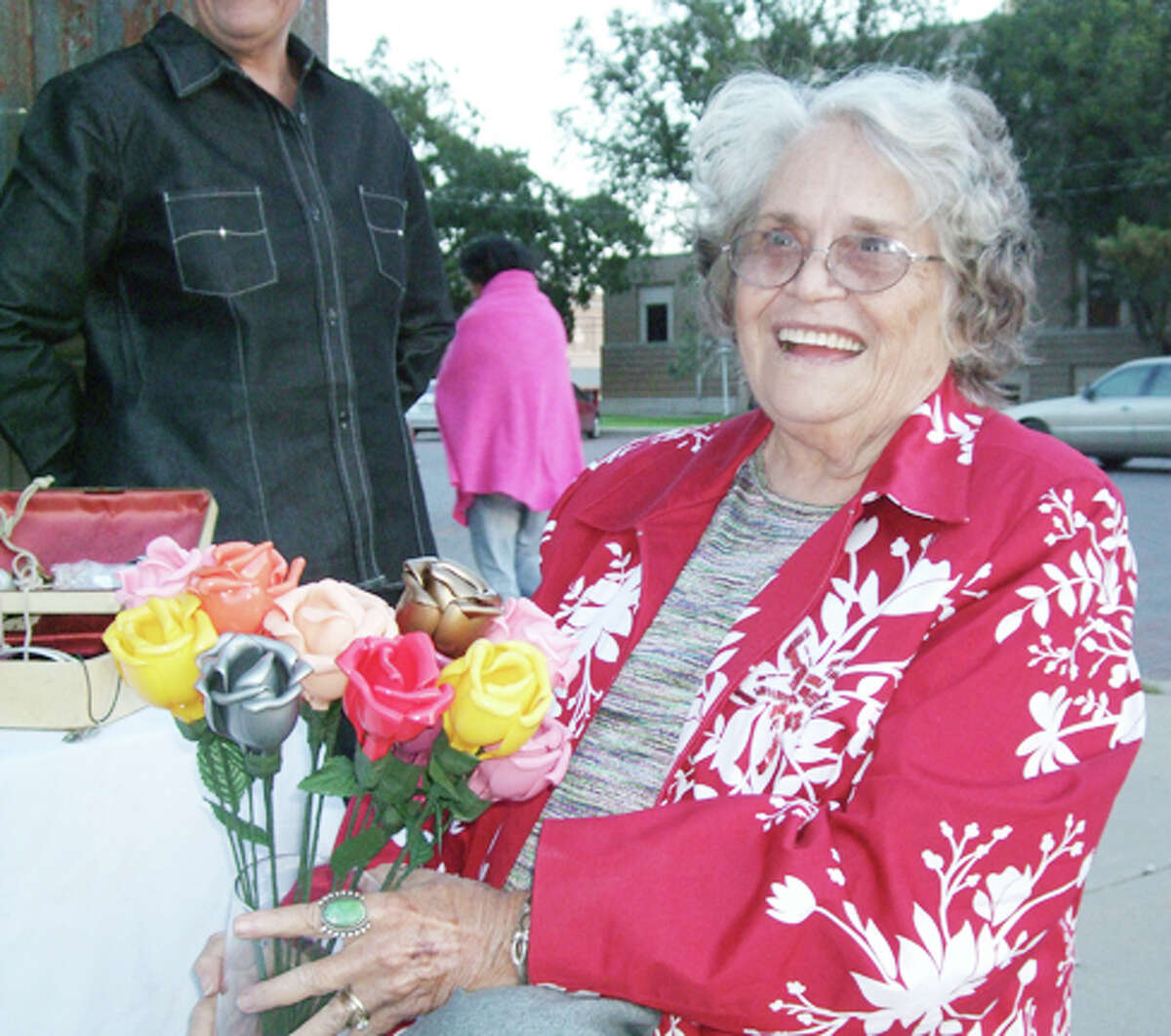 Sandy Hollars, of Hand Made Creations by Gram, sits in front of roses that her daughter crafted from plastic spoons at the first Artwalk Plainview, Oct. 5, 2012.