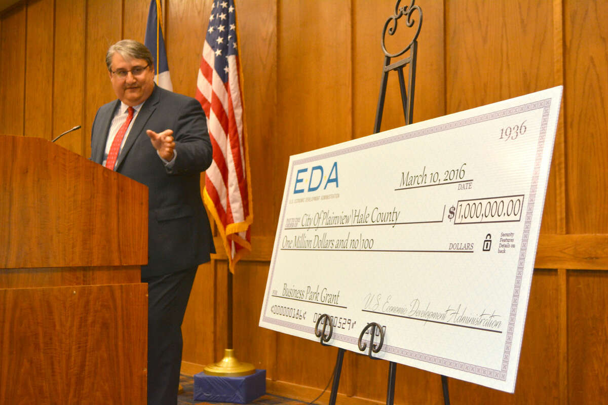 $1 million boost Doug McDonough/Plainview Herald Jorge Ayala of Austin, regional director of the U.S. Economic Development Administration, points to an oversize check Thursday while announcing that Plainview and Hale County are joint recipients of a $1 million grant to assist in the development of Plainview's new industrial park.