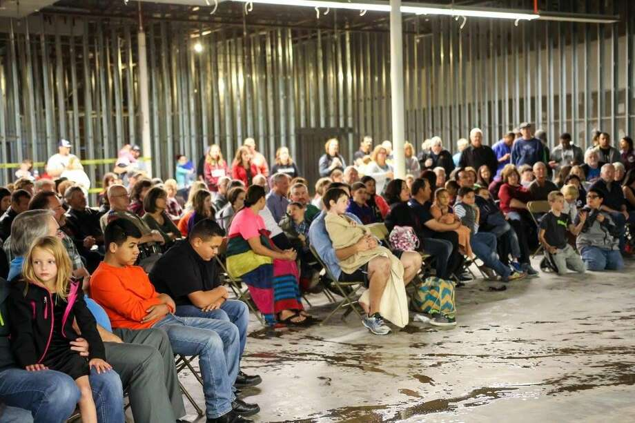 Members of the Harvest Christian Fellowship church in Plainview hold a special baptism service at the construction site of their new church, a former Super Kmart. Photo: Courtesy Photo