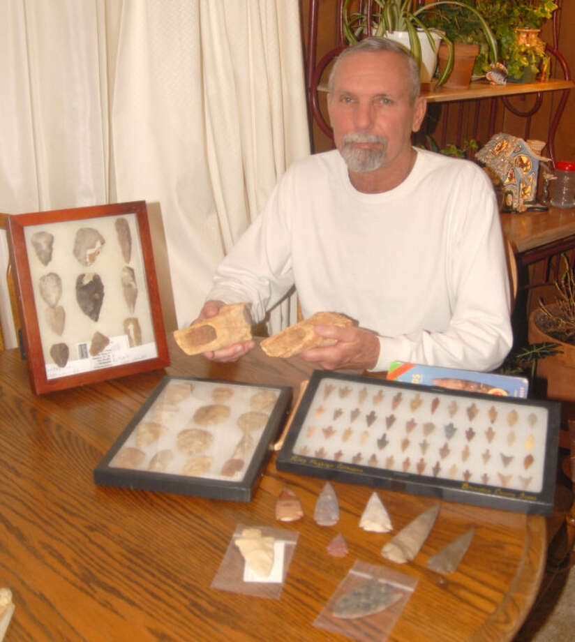 Doug McDonough/Plainview HeraldLarry Perkins found his first broken piece of flint from an Indian arrowhead at age 11 along the Running Water Draw. A member of the Hi-Plains Rock Club, he now has a large collection of both authentic and reproduction arrowhead and spear points and Indian-crafted bone scrappers. Many will be on display this weekend at the 52nd Annual Gem & Mineral Show at the Ollie Liner Center.