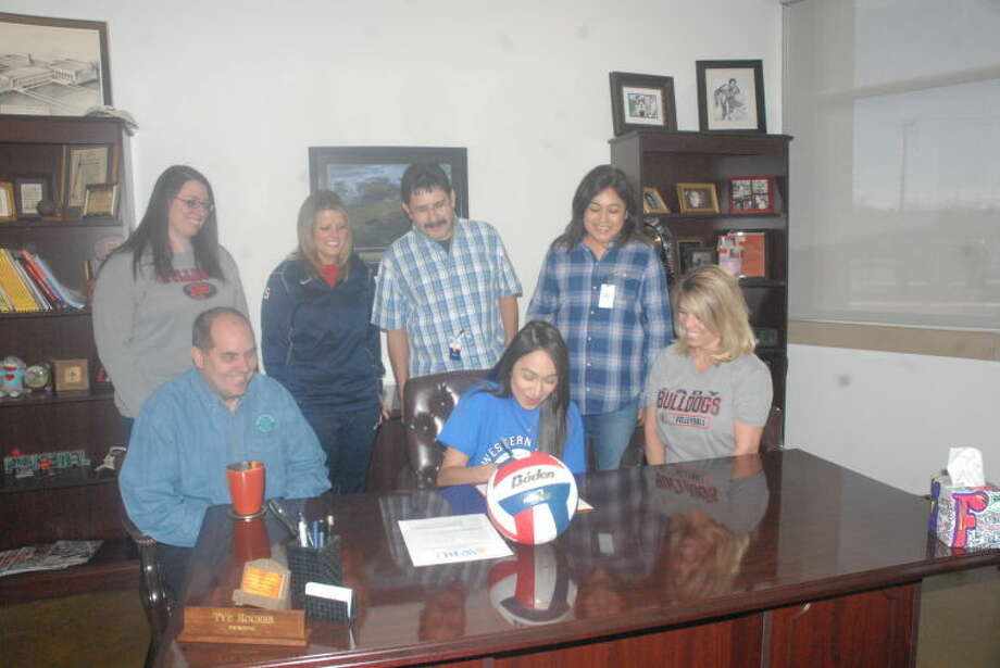 Plainview High School senior Lupita Quintanilla (seated, center) signs a letter of intent Thursday morning to play volleyball at Western Texas College in Snyder. Looking on (seated) are Western College volleyball coach George Hamilton (left) and Lady Bulldogs volleyball coach Torri Hatch (right). Standing are (from left) PHS assistant volleyball coach Keitha Bowman, PHS assistant volleyball coach Shelly Faught, Lupita's dad Ruben Quintanilla and her mom Connie Quintanilla. Photo: Skip Leon/Plainview Herald