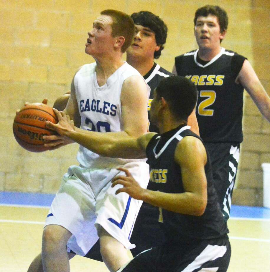 Plainview Christian Academy's Luke Brown goes up for a shot with Kress players surrounding him during a game this season. Brown, a 6-foot-1 senior, was a first team all-district selection and was voted to the TAPPS Class 2A all-state second team. Photo: Skip Leon/Plainview Herald