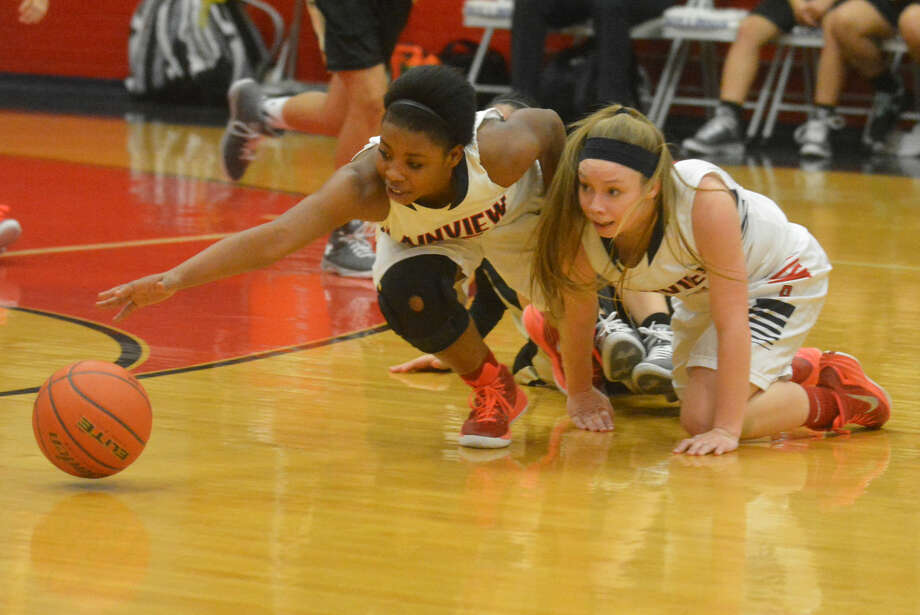 Plainview's Khyra Riddley (left) and Jaden Gonzales scramble on the floor after a loose ball during the Lady Bulldogs' final regular-season game. Plainview heads into the postseason with a bi-district game against Randall at Hereford Tuesday. Photo: Skip Leon/Plainview Herald