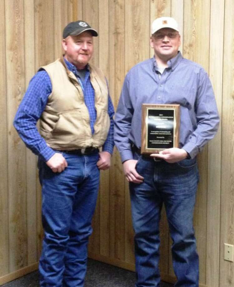 Courtesy PhotoRob Bass was recognized at Monday's Hale and Swisher County Crops Conference as Hale County's 2013 Outstanding Conservation Farmer. He received a plaque from Jeff Harrell, Hale County Soil and Water Conservation District board member.