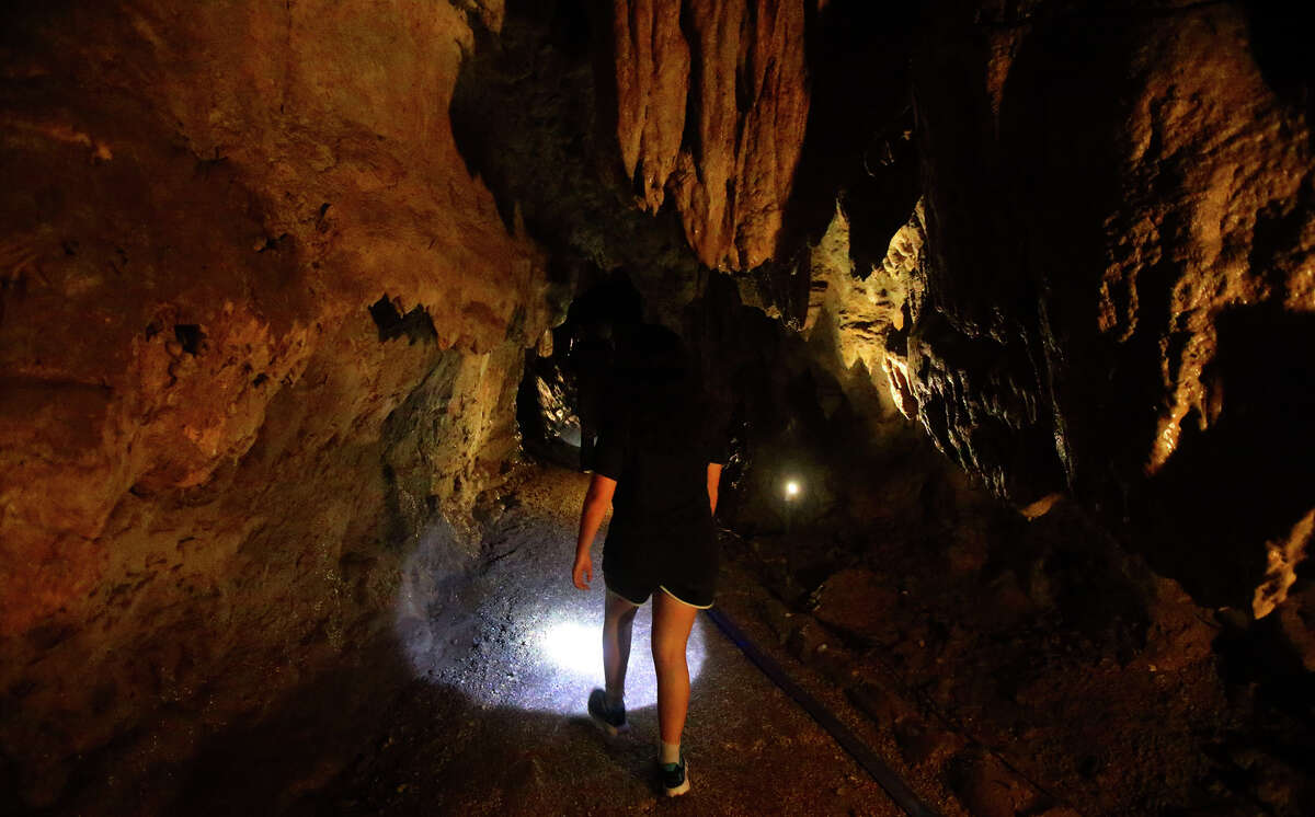 Visitors to Cascade Caverns explore Thursday July 14, 2016. Cascade Caverns president Lance Kyle is concerned about springs and water flow to the caverns because of a proposal for a utiity in the area to drill a new well nearby.