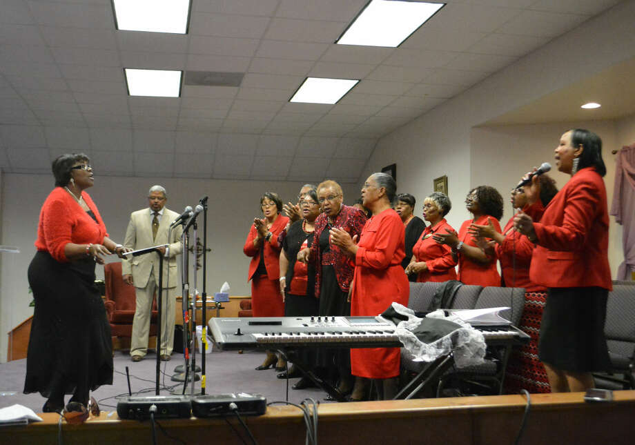 Doug McDonough/Plainview Herald The Mass Choir, with Pastor Sandra Gardner (right) of Rehoboth Christian Worship Center as featured vocalist, performs Sunday during the grand finale of Plainview's 28th annual Black Awareness Service. New Jerusalem Baptist Church in Finney hosted the community event.