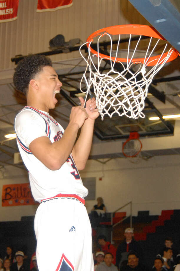 Plainview's Zach Riddley yells as he cuts down the net following the Bulldogs' victory over Abilene Cooper at the Dog House Tuesday night to clinch the District 4-5A championship. Photo: Homer Marquez/Plainview Herald