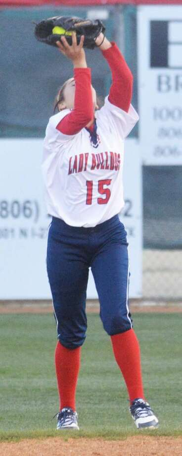Plainview's Justus DeLeon catches a fly ball during a softball game earlier this season. The Lady Bulldogs split four games over two days at a tournament in Snyder Friday and Saturday. Photo: Skp Leon/Plainview Herald