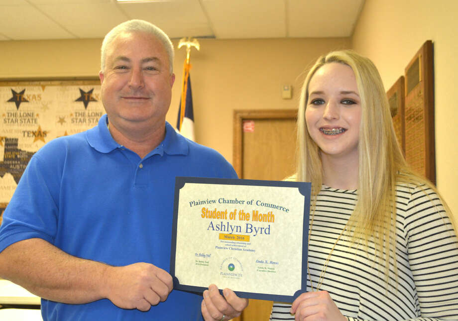 Photos by Doug McDonough/Plainview Herald Student of the Month Ashlyn Byrd, Plainview Chamber of Commerce Student of the Month, receives her certificate Tuesday from First Vice President Tim Hardage. The 17-year-old daughter of Christi and Bobby Byrd, she is a senior at Plainview Christian High School. An artist, she won a bronze medal in paper art and third place in watercolor at the ACSI Competition in Amarillo. She is a member of the National Honor Society and enjoys photography, gardening and playing with her dogs. Byrd is an active member of her church youth group, volunteers with Snack Pac 4Kids and Meals on Wheels and helps as needed at church. She is a member of the Junior Literacy Council and babysits part time. Byrd plans to attend Abilene Christian University and become a speech pathologist.