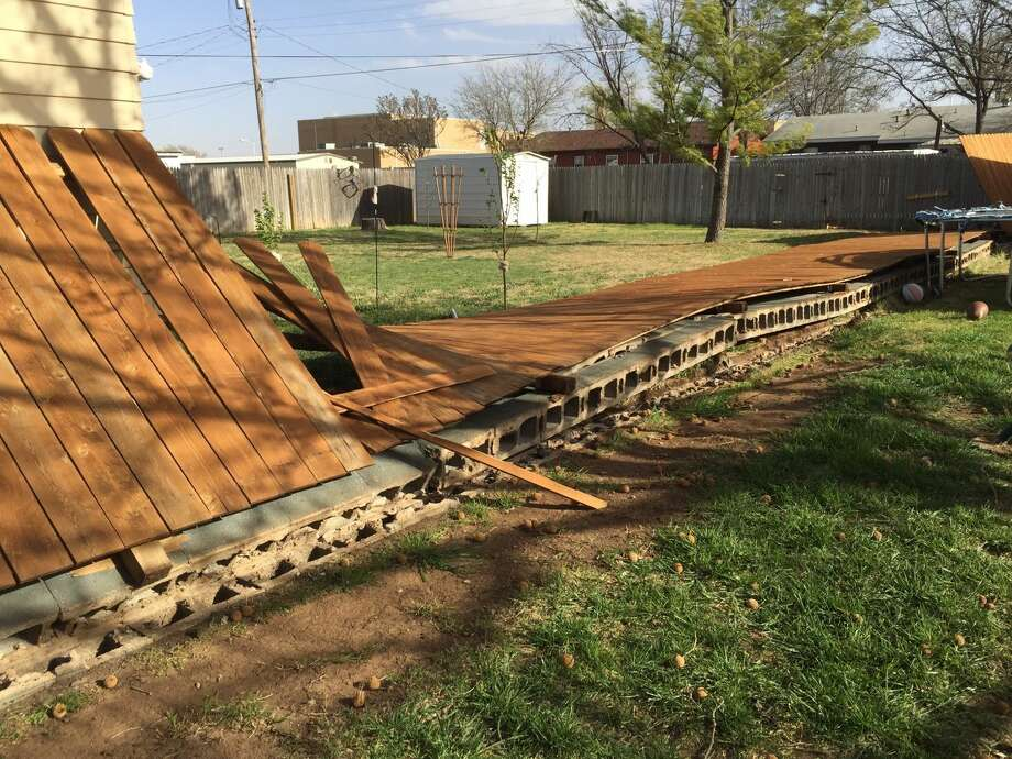 High winds were strong enough to knock over a cinderblock fence Wednesday at 1610 Smyth St. Photo:  Homer Marquez/Plainview Herald