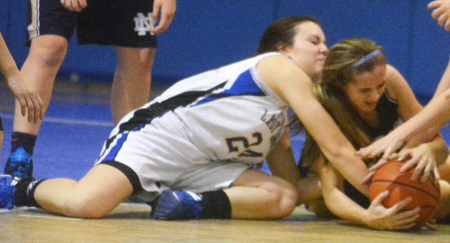 Plainview Christian Academy's Abbey Maresca (left) gets on the floor to grab a loose ball along with a Wichita Falls Notre Dame player during a game earlier this season. The Lady Eagles will travel to Sherman to play Texoma Christian in a bi-district playoff game at 11 a.m. Saturday. Photo: Skip Leon/Plainview Herald