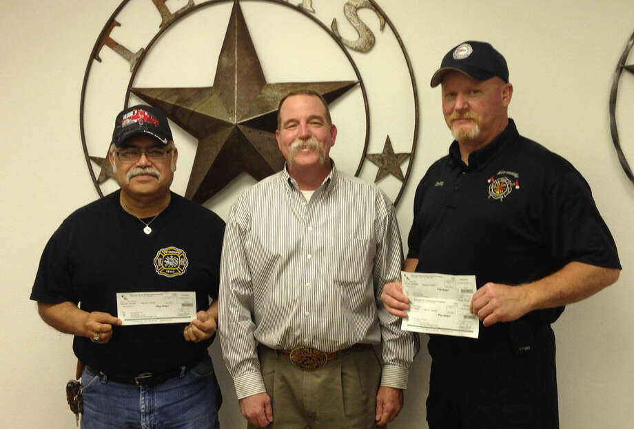 Courtesy Photo In recognition of their work in responding to fires involving property it insures, Texas Farm Bureau Insurance, represented Hale County Farm Bureau Agency manager by Bobby Byrd (center), presents a $150 check to Jesse Marquez (left) of Petersburg Volunteer Fire Department and $300 to Kelly Vandergriff of Abernathy Volunteer Fire Department. The payments are made to help offset expenses incurred by rural departments while responding to calls and help them purchase needed equipment.