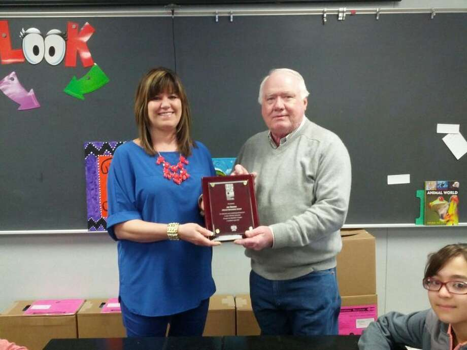 Homer Marquez/Plainview HeraldHillcrest science teacher Jan Reeves receives a special plaque for her efforts in teaching students the importance of water conservation. Presenting the award is High Plains Underground Water Conservation District Director Ronnie Hopper of Petersburg.