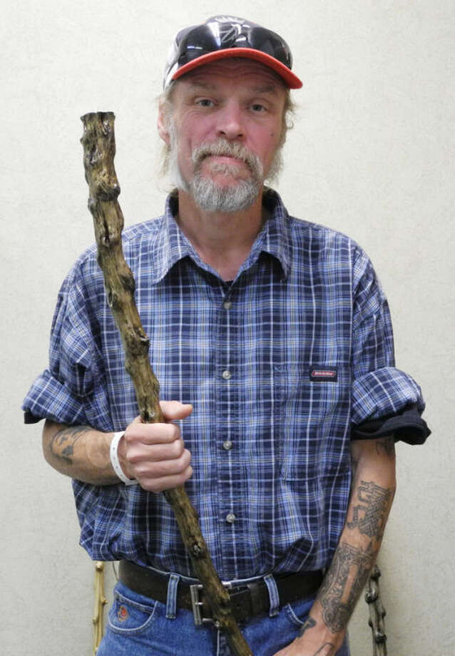 Gail Williams/Plainview HeraldDon Millirons holds one of the swagger sticks he made out of a common tumbleweed. Millirons has been making the sticks since 1986.