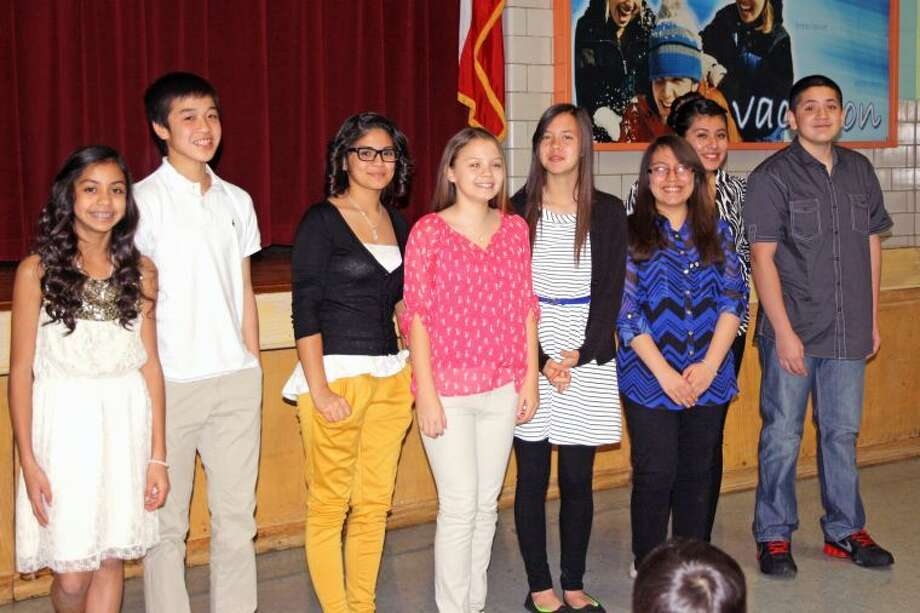 Jan Seago/Plainview ISDEstacado students Kristan Rincon (left), Tai Tien Phan, Maria Munez, Sage Landeros, Angela Hunley, Samantha Hernandez, Crusita Cruz and Erick Castillo were inducted into the National Junior Honor Society during a ceremony Monday.