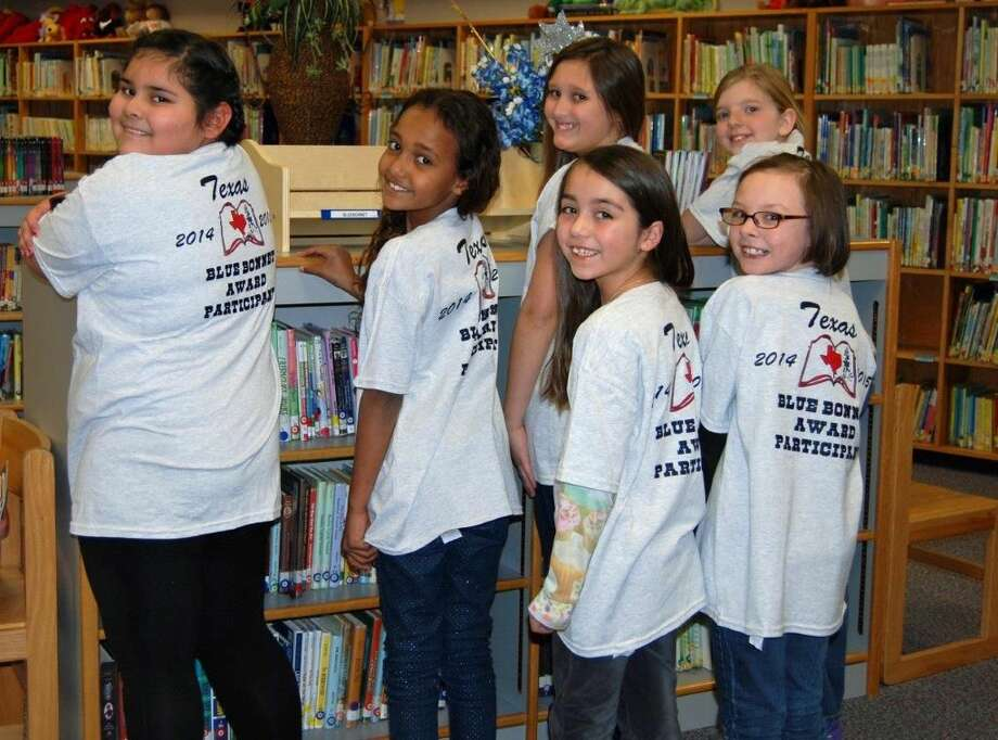 Teresa Kinkaid/La Mesa ElementaryLa Mesa Elementary students Micah Rodriquez Vega, Tatiana Wilkinson, Kya Martinez, Jeanie Harris, Kylie Carter (back), and Eleanore Beard display the t-shirts purchased for them by LaMesa PTA recognizing them as qualifying voters for the Texas Bluebonnet Award.