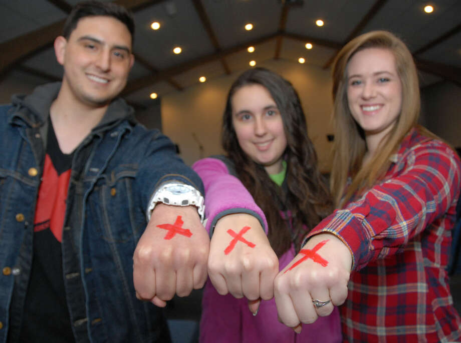 Jonathan Petty/Wayland Baptist UniversityWayland Baptist University students Anthony Minjares (left), Hobbs, N.M.; Savanna Ludecke, Frisco freshman;and Nicole Adams, Amarillo senior, display the red X of the End It movement to raise awareness of human trafficking. The Baptist Student Ministries and these students are leading an effort to combine the 30-Hour Famine with the End It movement to raise awareness and money to benefit victims of human trafficking.