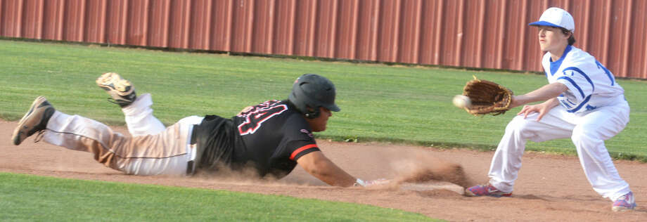 Lockney's B.J. Jimenez dives back to second base as Olton second baseman Jaden Leathers takes the late pickoff throw in the fifth inning of a District 4-2A game at Lockney Tuesday. The Longhorns raised their season record to 11-1 (5-1 in district) with a 13-3 victory. Photo: Skip Leon/Plainview Herald