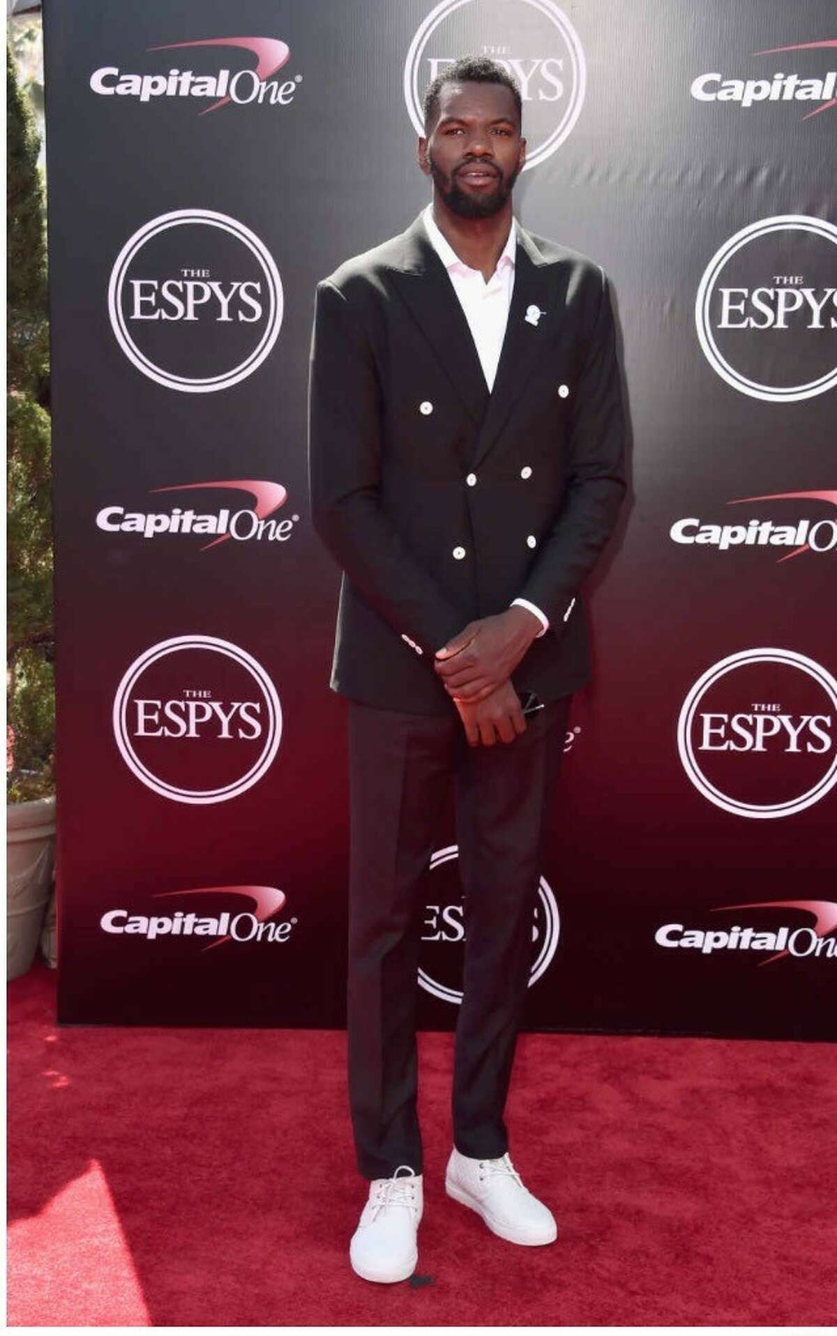 Dedmon's ESPYs red carpet look: a custom double-breasted jacket, white button down, black pants and Del Toro shoes, all custom-made for him, Doyle said.