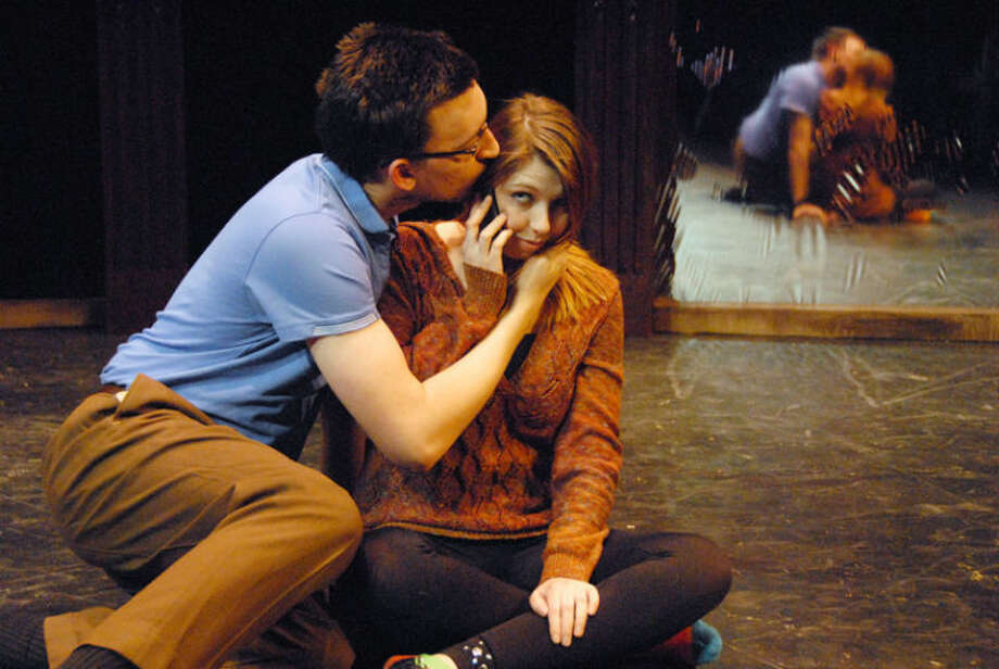 Schultz, played by Joshua Walters, kisses Theresa, played by Jordan Sisson, during a scene in 'Circle Mirror Transformation.' The play will be performed by Wayland Baptist University theater Feb. 27-March 1 at 7:30 p.m. in the Black Box theater in Harral Auditorium. Photo: Courtesy Photo