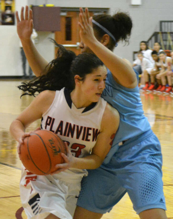 Plainview's Karli Wheeler runs into an El Paso Chapin player as she tries to drive to the basket in an area playoff game Friday. Wheeler scored 24 points, including 11-of-13 free throws, to lead the Lady Bulldogs to victory. Photo: Doug McDonough/Plainview Herald