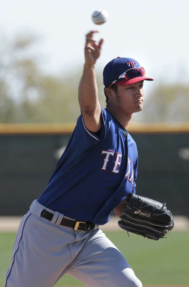 The Texas Rangers' Yu Darvish throws at training camp in Surprise, Ariz., this week. Darvish has been tapped to be the opening day starter for the Rangers.  Photo: Ron T. Ennis/Fort Worth Star-Telegram/MCT