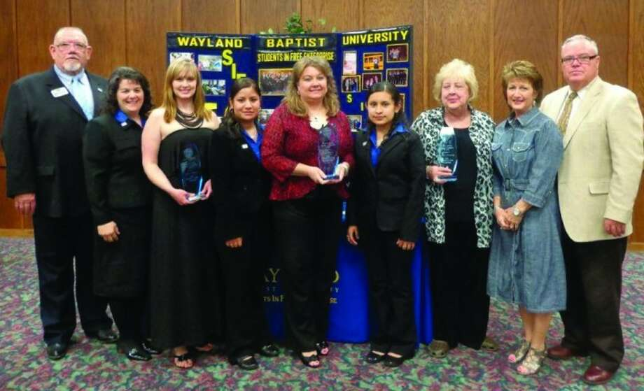 Wayland Baptist University PhotoWayland Baptist University's chapter of Students in Free Enterprise recognized three local women April 19 at its annual Women in Business banquet. Shown following the presentations are Dr. Sam VanHoose (left), SIFE sponsor; Christine Haynes, SIFE president; Cer issa Wardlow Stockdale, accepting for DeLynn Wardlow of It's a Girl Thing; Maria Carrilo, SIFE secretary; Cindy Wieland, Hale County State Bank; Rosaura Luevano, SIFE member; Deliece Harrison, Hale County Abstract; Debbie Lane, administrative assistant for the School of Business; and Dr. Otto B. Schacht, dean of the School of Business.