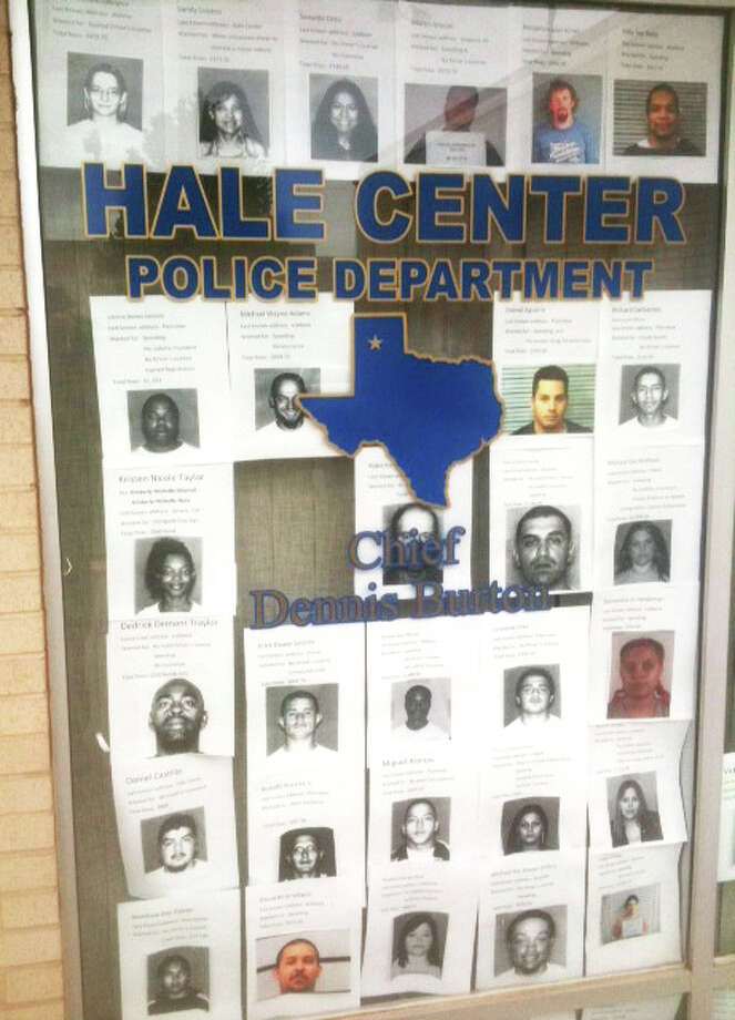 Courtesy PhotoReminiscent of the Old West, wanted posters of individuals with outstanding warrants fill a window at Hale Center's City Hall and Police Department. According to Hale Center Police Chief Dennis Burton, the city's outstanding warrants represent more than $200,000 in uncollected fines with a large number of the suspects from Plainview, Lubbock and Amarillo.