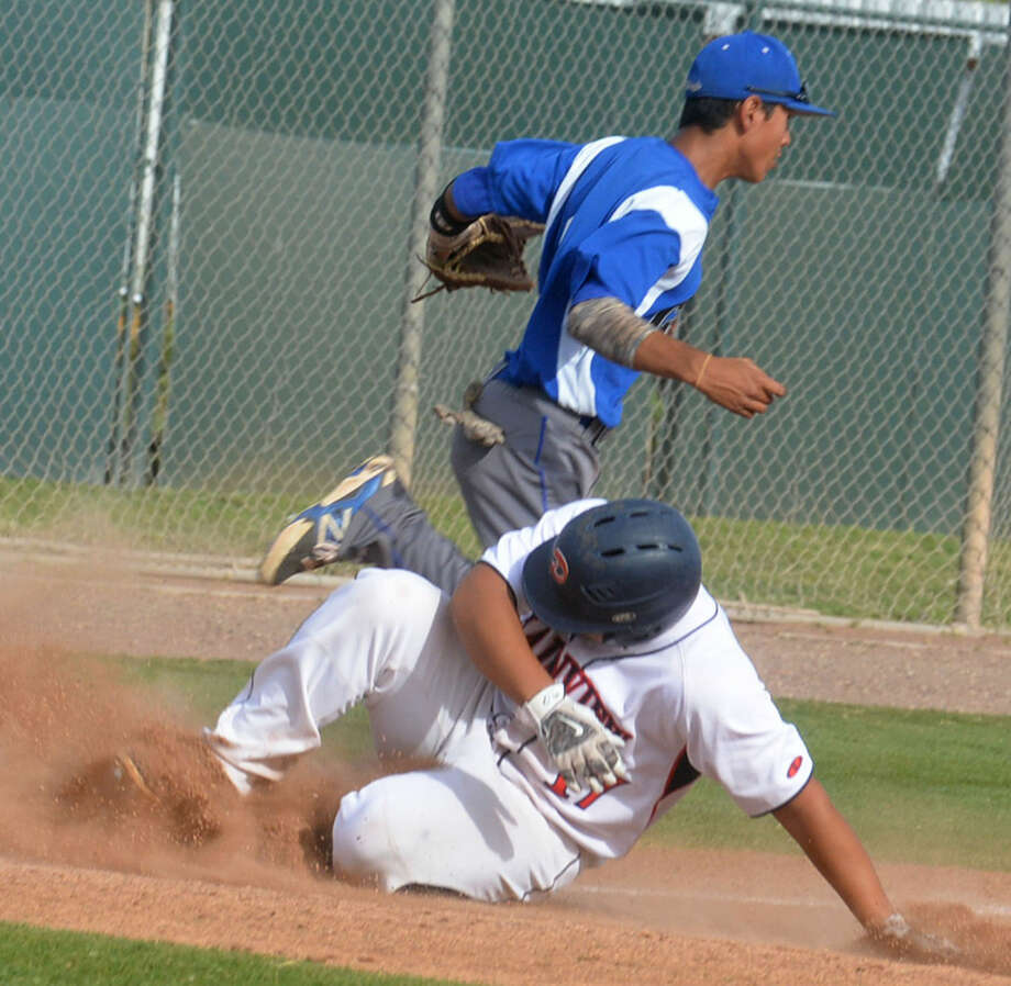 Plainview's Nathaniel Armijo slides into third base in the second inning of a District 4-5A game against San Angelo Lake View Tuesday. The throw got past the third baseman and Armijo scored one of his four runs in the game on the play. Plainview won, 23-1, to raise their district record to 3-2. Photo: Skip Leon/Plainview Herald