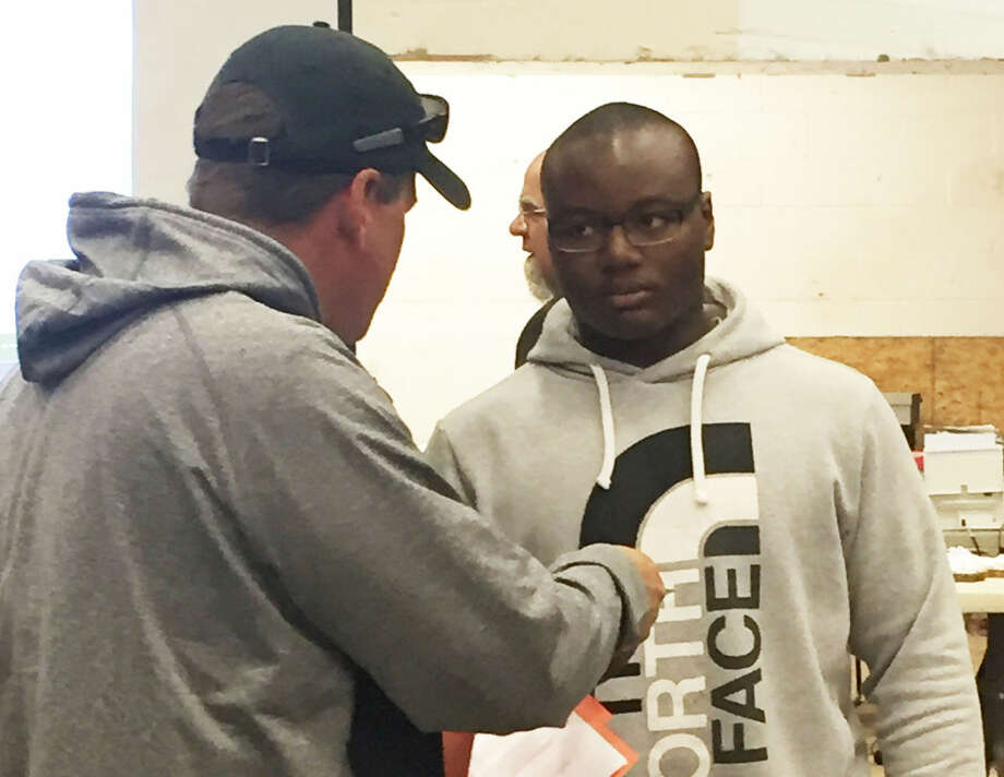 Plainview's Roy Abanonu, right, receives the Region 1, Division 1 Academic Scholarship at the boys' state powerlifting championships in Abilene. Abanonu finished 14th in the 242-pound weight class. Photo: Courtesy Photo