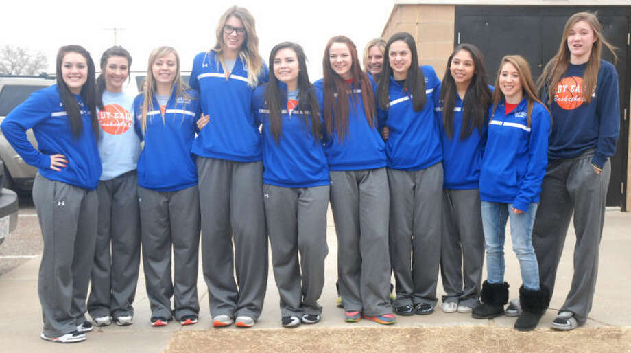 The Plainview Christian Academy Lady Eagles basketball team and coach Andra French get ready to leave for their regional game Tuesday morning. The team leaves this afternoon for Mansfield and the state tournament. It is the Lady Eagles' first appearance at the state tourney in four years. They will play Granbury Happy Hill Academy in the semifinals Friday afternoon. Photo: Skip Leon/Plainview Herald
