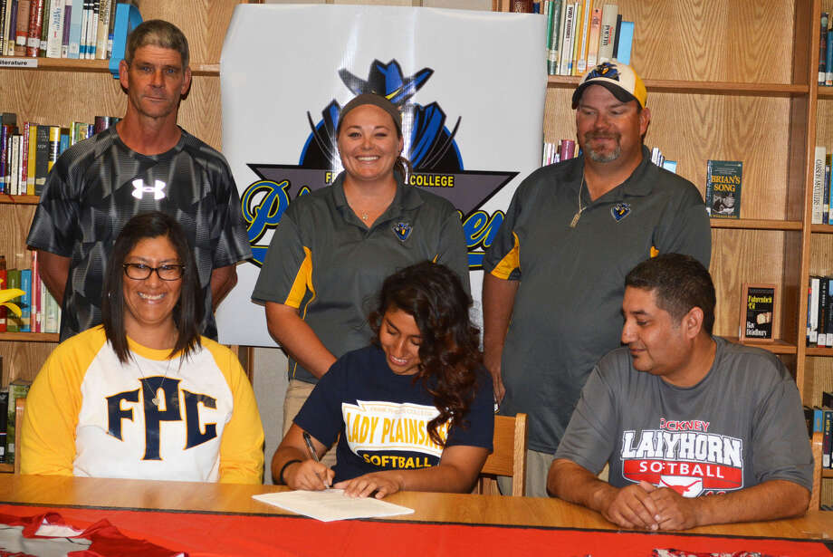 Lockney High School senior Lexi Chavez, seated center, signs to play softball at Frank Phillips College in Borger. She is flanked by her parents, Gracie Chavez, left, and Adam Chavez, right. Standing, from left, are Lockney athletic director and softball coach Malcolm Moerbe, Frank Phillips College assistant coach Taylor Jones and Frank Phillips College head coach Lucas Grider. Photo: Skip Leon/Plainview Herald
