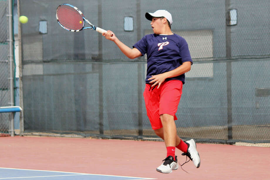 Plainview's Trey Perez has both feet off the ground as he puts everything into a forehand during a mixed double match at the District 4-5A Tennis Tournament at the Plainview High School courts Thursday. Action will continue Friday with consolation and championship matches. Photo: Photo Courtesy Of Curtis Bailey/PISD